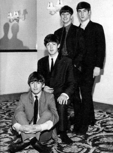 I just adore this one! It's almost like a Beatle family foto :)