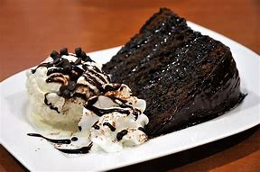 Hot chocolate fudge cake and ice cream !! To die for *lol* !!