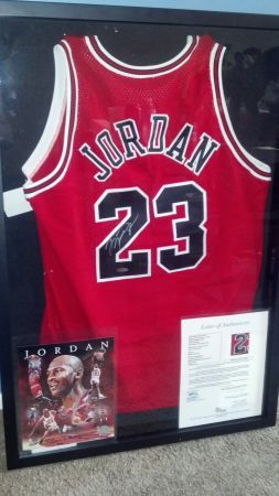 I have a mint condition Michael Jordan signed jersey that has the original tags and has been authenti