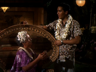 "प्यार Blue Hawaii, especially the part where he sings ""Can't Help Falling In प्यार With You"""