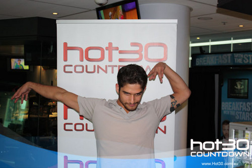 Tyler Posey wallpaper probably with a sign titled  Visiting Hot 30 Countdown in Sydney