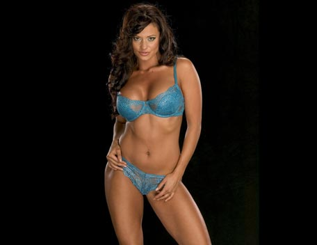 Candice Michelle Hintergrund with a brassiere titled Candice Michelle Photoshoot Flashback