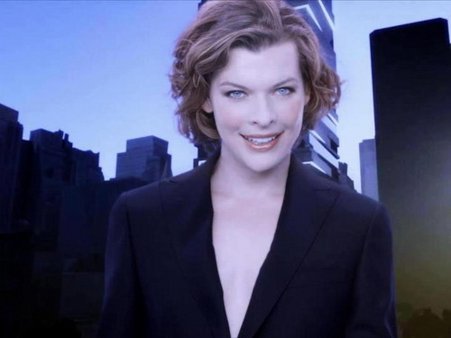 Milla Jovovich karatasi la kupamba ukuta containing a business suit, a suit, and a well dressed person titled Milla
