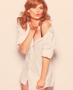 Stana Katic hình nền probably containing bare legs, a well dressed person, and a playsuit, người chơi titled Stana Katic EW Magazine