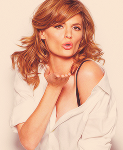Stana Katic achtergrond with a portrait entitled Stana Katic EW Magazine