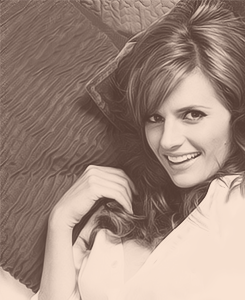 Stana Katic karatasi la kupamba ukuta probably containing a portrait titled Stana Katic EW Magazine