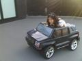 Courteney driving a small truck