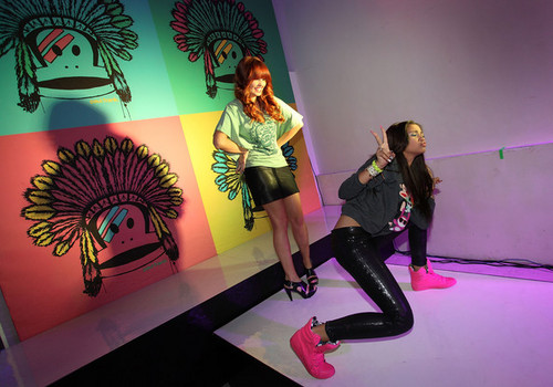 Debby Ryan karatasi la kupamba ukuta with a hip boot titled Debby Ryan at the 'Paul Frank Fashion's Night Out '