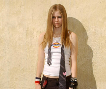 Avril Lavigne wallpaper probably containing a hip boot, a legging, and long trousers entitled Dickies T-Shirt Photoshoot 2002