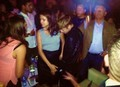 Justin and Selena at a club