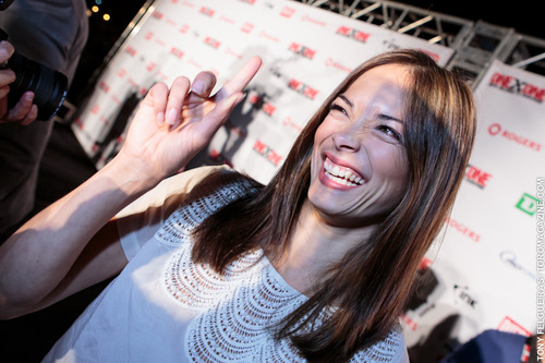 Kristin Kreuk wallpaper probably containing a sign entitled Kristin at OneXOne Event (September 2012)