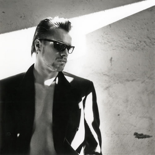 U2 wallpaper possibly containing sunglasses and a business suit entitled Larry