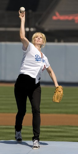 Throws out the first pitch before the start of the LA Dodgers and San Francisco Giants baseball game