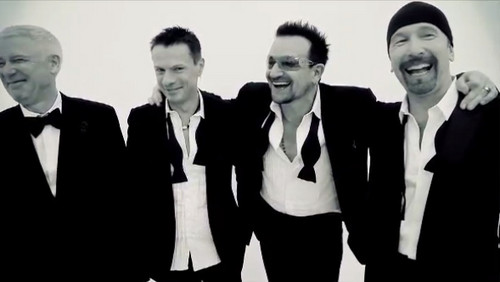 U2 wolpeyper with a business suit, a suit, and a three piece suit called U2 (GQ Magazine)
