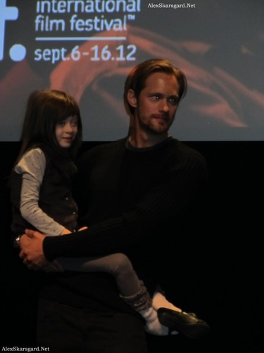 Alexander Skarsgård wallpaper with a sign titled What Maisie Knew Q&A at TIFF