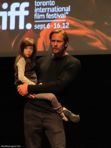 Alexander Skarsgård 壁纸 with a sign entitled What Maisie Knew Q&A at TIFF