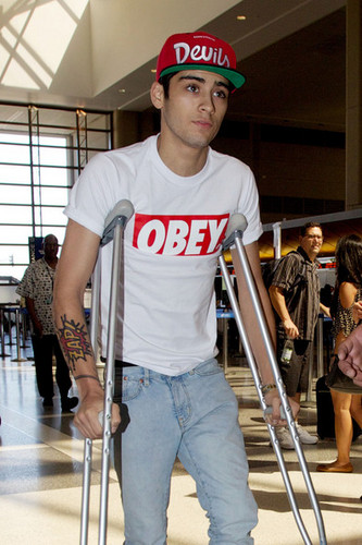 Zayn on crutches