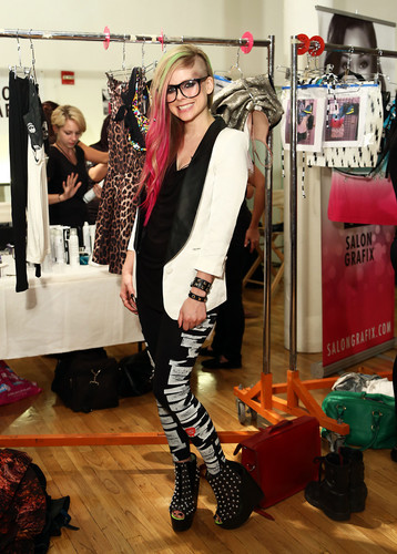Avril Lavigne wallpaper possibly containing a hip boot, an outerwear, and a top entitled Abbey Dawn at New York Fashion Week - Backstage (10 Sep 2012)