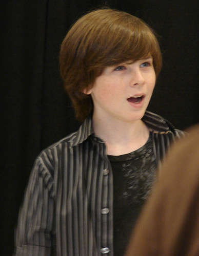 Chandler Riggs Hintergrund probably containing a well dressed person and an outerwear entitled Chandler
