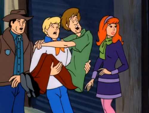 Scooby-Doo wallpaper containing anime titled Fred Holding Shaggy