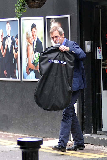 Hugh Laurie is seen exiting a tuxedo rental دکان on Grafton سٹریٹ, گلی 19.09.2012
