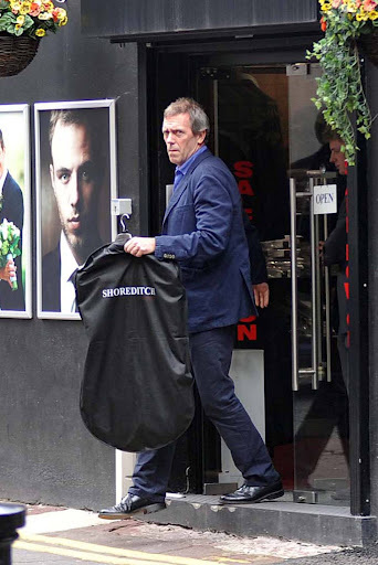 Hugh Laurie is seen exiting a tuxedo rental kedai on Grafton jalan 19.09.2012
