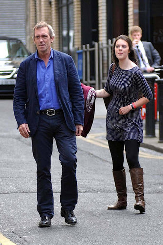 Hugh Laurie wallpaper with a street and a business suit called Hugh Laurie is seen exiting a tuxedo rental shop on Grafton Street 19.09.2012