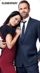 Sherlock & Joan karatasi la kupamba ukuta containing a business suit, a suit, and a pinstripe titled Jonny Lee Miller & Lucy Liu {TV Guide Magazine}