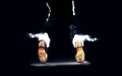 Michael Jackson Hintergrund possibly containing a hip boot and a cowboy boot titled KING OF POP