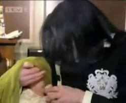 "Michael Feeding His Youngest Son, ""Blanket"""
