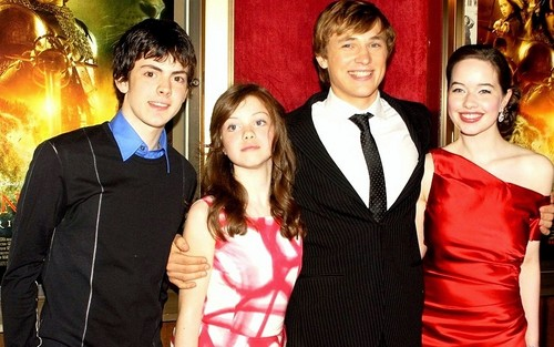 the chronicles of narnia wallpaper probably with a bridesmaid, a business suit, and a dress suit entitled Narnia Cast - Peter, Susan, Edmund and Lucy