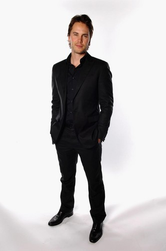 Taylor Kitsch wallpaper containing a business suit, a well dressed person, and a suit entitled Taylor - CinemaCon Portraits (2012)