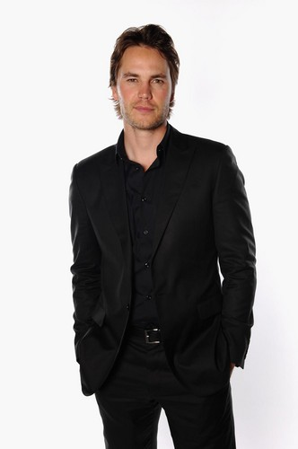 Taylor Kitsch wallpaper containing a business suit and a suit titled Taylor - CinemaCon Portraits (2012)
