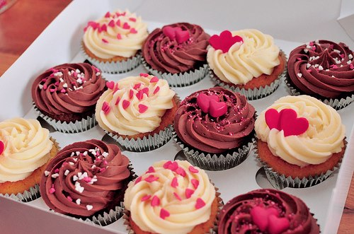 delicious cakes sprinkled with merah jambu hearts