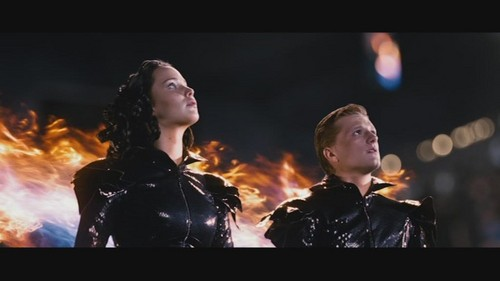 Katniss Everdeen wallpaper with a concert entitled katniss and peeta