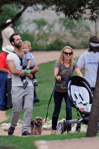 Taking a walk in the park with her family during a break from filming in Austin, TX (October 3rd 20