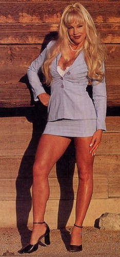 Former WWE Diva... Debra پیپر وال probably with bare legs, hosiery, and a hip boot called Debra - Raw Magazine December 2000