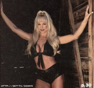 Frühere WWE-Diva… Debra Hintergrund with attractiveness and a bikini titled Debra - Raw Magazine December 2000