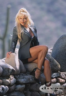 Former WWE Diva... Debra achtergrond possibly with a hip boot called Debra - Raw Magazine December 2000