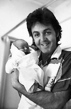 Delighted Paul and newborn Mary