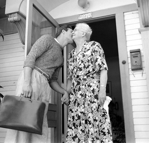 Marlon Brando kisses his grandmother as he heads to the studio for a dia of filming The Men, 1949.