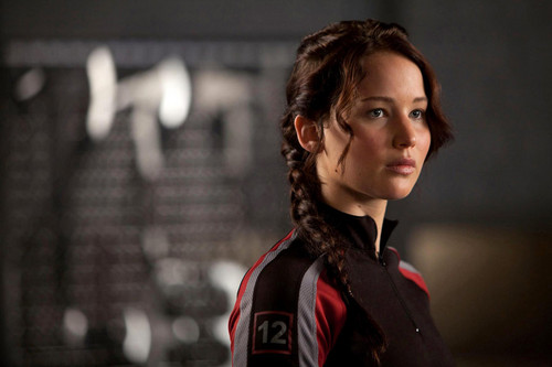 Katniss Everdeen wallpaper probably with an outerwear titled katniss