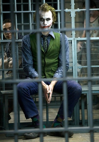 The Joker kertas dinding with a business suit, a well dressed person, and a suit titled the joker