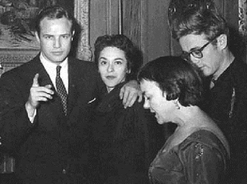 At a party with Movita early in their relationship. James Dean was also in attendance.