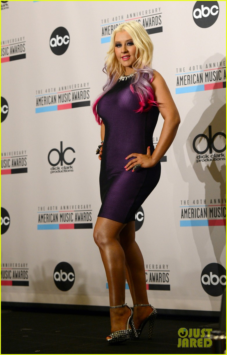 http://images6.fanpop.com/image/photos/32400000/Christina-Aguilera-speaks-onstage-during-the-2012-American-Music-Awards-nominations-press-christina-aguilera-32426789-781-1222.jpg
