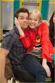 Emma Stone poses with Miranda Cosgrove on the hit show iCarly, airing on Saturday oct 20 2012