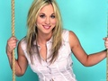 Kaley infront of blue backdrop
