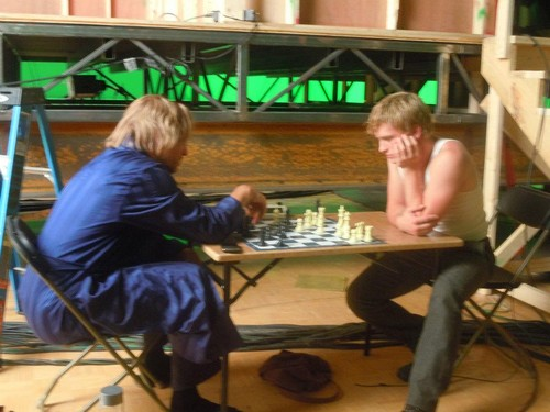 Peeta and Haymitch playing chess
