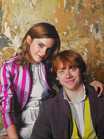 Rupert Grint wallpaper possibly containing a well dressed person, a business suit, and an outerwear entitled Rupert&Emma