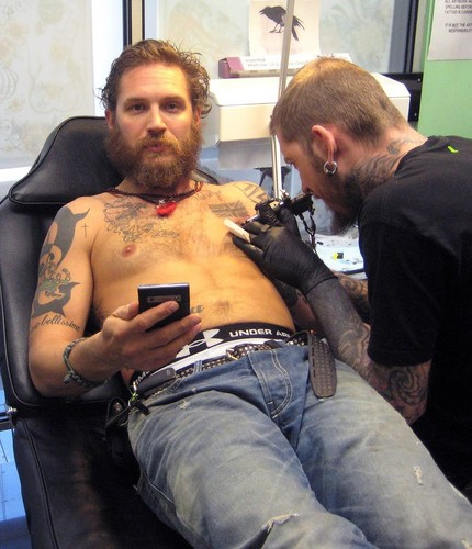 Tom Hardy getting his latest ink..